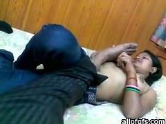 Luscious Indian chick lies topless on a bed. Horny guy thrusts his dick in her mouth so she sucks engorged dick like tasty lollipop.