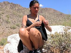 Slim and pretty brunette babes hikes in the mountains. She decides to have a break. So, she takes clothes off and sits down on a rock. She fondles her nipples and also rubs pussy lips.