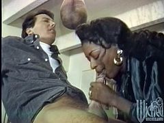 Lustful Black woman comes up to the guy and drops to her knees. She sucks his dick and also licks balls. The guy cums on Diane's face.