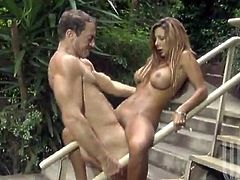 Stunning girl gets her juicy tits licked on the steps outdoors. Then Demi drops top her knees and gives a blowjob to the guy. She gets fucked in her pussy and between boobs.
