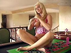 She is a naughty and sizzling sexy doll always on hunt of some places, to masturbate at. Here is what she does on the poker table!