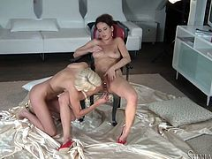 Gorgeous lesbians Lena Love and Eve F are making love indoors. They kiss and finger each other's pussies and then fuck them tenderly with dildos.