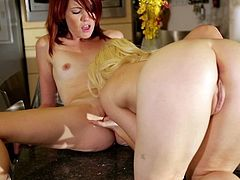 Enjoy warm pussy fingering and licking during sensual kitchen lesbian show