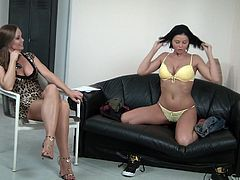 Make sure you a look at this hot scene where a sexy brunette takes off her clothes and plays with herself as another hottie watches her in action.