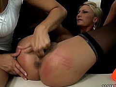 Blonde Katy Parker with massive knockers gets her wet hole stretched by lesbian Pearl Diamond