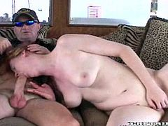Salacious redhead chick Doria is having fun with some guy on a yacht. She shows her natural tits to the stud and then drives him crazy with a passionate blowjob.
