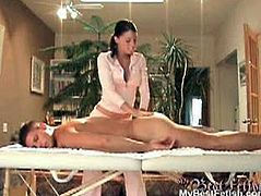 A stud lays down on Tiffany Preston's massage table. When he turns around, she sees his erect cock and he unzips her blouse. She grabs his penis and stokes it.