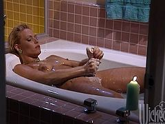 Horny blonde Debi Diamond is taking a bath. She strokes her nice wet body passionately and then pours hot wax on her amazing ass.