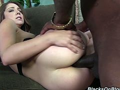 Charming brown-haired girl Remy LaCroix is getting naughty with a black dude indoors. She pleases him with a blowjob and then lets him pound her butt in missionary position.