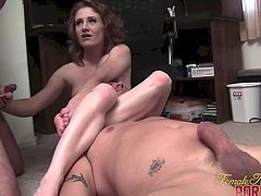 Flexible Redhead Lucy Fire Takes on Two Cocks