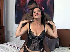 Have a blast watching this brunette MILF, with big jugs wearing stockings, while she gets nailed hard by a black dude over a nice bed.
