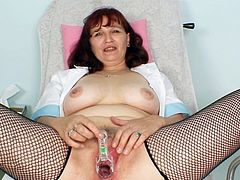 Mature nurse loves posing her wet cunt in a naughty solo session