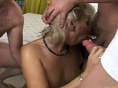 This mature whore is so fucking horny that's unbelievable. Sex-starved bitch needs at least four cocks to satisfy her lust. She gets her greasy pussy filled with pretty thick cock but she has three more cocks to handle in this hot sex video.