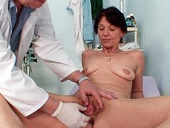 Hot mature gets truly horny while feeling the doctor's hands sliding her cunt