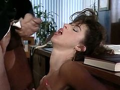 Voracious brunette secretary attacks boss's fat cock with her mouth
