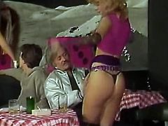 Crowd of fuck thirsting guys with throbbing penises watch dancing broad asses provocative blond head stripper. She demonstrates how flexible she is, guys are in delight. Watch this filthy stripper in The Classic Porn sex clip!