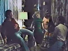 Horny couples switch their sex partners having dirty swinger party. Watch them having filthy foursome sex in arousing vintage porn clip.