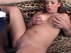 A passionate redhead girl gives a blowjob to a Black guy. Then Sandra Black lies down on a sofa and gets her trembling pussy destroyed.