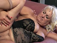 Dana Hayes is a mature blonde with huge natural breasts and a great need for sex. Watch her man drill her wet pussy after eating her out.