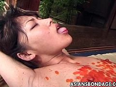 Japanese brunette girl gets burned with candle wax