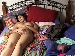 Lusty Indian babe with big natural boobs fingers her snatch