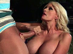 Hot blonde MILF in stockings has sex in the moonlight. She blows a dick and also licks balls. Then she lies down on the ground and gets rammed in her dripping pussy.