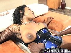 This black chick wants her neighbor's dick in her pussy so she invites him to her place. She spreads her legs wide indicating how bad she wants him to fuck her in her tight pussy. Horny dude is powerless to resist her. He pounds her fanny ruthlessly in and out. Then he fucks her from behind.