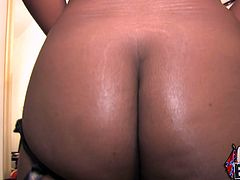Get a boner watching this ebony babe, with giant tits wearing black lingerie, while she gets gangbanged and moans like a real slut!