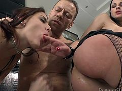 Get a load of this hardcore scene where these two horny babes share this guy's big fat cock in a threesome.