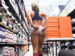 Naughty Ann goes to a sporting goods store, sits down, and pulls her shorts to the side so she can finger her pussy in public.