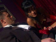 Nasty brunette Kaylani Lei wearing a dress and sexy gloves is having fun with some guy in a theatre. She takes the man's cock out of his pants and begins to rub it passionately.