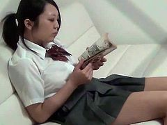 Mei is a Japanese schoolgirl who is filmed by a spy cam when she is alone. She rubs her furry cunt with a book before she puts her panties aside and rubs it properly.