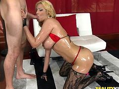 Press play to watch this blonde cougar, with gigantic boobs wearing sexy stockings, while she gets drilled hard covered in oil by a naughty man.