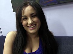 Magnificent brunette porn star with an engaging smile takes off her clothes. This beauty shows her nice boobs and feet in a backstage video.