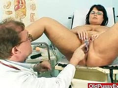 He lays this busty, BBW mature amateur on the exam table then once he has her in the stirrups he fingers her tight pussy.