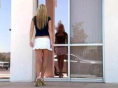 Touch yourself watching this blonde chick, with giant boobs wearing a miniskirt, while she jumps and moves erotically outdoors in a solo model video.