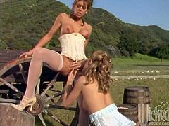 These two sexy pioneer babes take a break, strip off their dresses, and lick that pussy right there on the covered wagon.