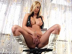 Alannis poses for the camera in leather lingerie and high boots. Then this solo girl sits down on a chair and starts to toy her pussy with the dildo.