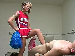 Watch this hot scene where this naughty teen dressed as a cheerleader teases this guy before sucking and letting fuck her in a locker room.