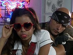 Amazing chick Lupe Fuentes wearing a miniskirt and glasses is having fun with a man in an office. She kneels in front of him and sucks his boner till it explodes with jizz.
