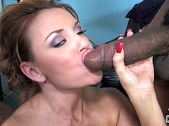 She seduces this lucky black dude to get him enormous black rod. She sucked that massive boner and then let him to nail her wet cunt.