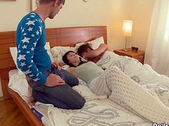Adorable black haired babe was sleeping when two cocky boys joined her in bed. One guy roughly fucked her tight pussy missionary style while babe sucked other boy's big dick. Then teeny babe got her sweet snatch banged doggystyle.