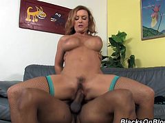 An busty woman with an amazing pair of tits and a huge ass doesn't stop moaning while she gets fucked hard by a black guy with a huge throbbing cock in all positions.