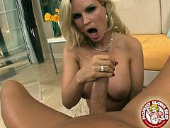 Jaw dropping blonde tramp with big hooters Diamond Foxxx sits between legs of her lover and desirably sucks his big shaved dick. Bitch strokes that long shaft and polishes it with her tongue.