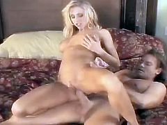 Have a good time watching this blonde cougar, with big fake boobs wearing cute panties, while she gets nailed hard by a steamy fellow.
