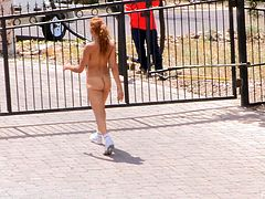 Stunning babe jogs in a public park. It is very hot outside, so she takes her sportswear off and walks in the park. She does not care that people see her naked body. On the contrary, she likes it.