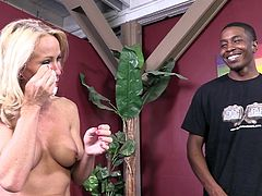 Press play to watch this blonde cougar, with big knockers wearing black stockings, while she tells her thoughts about being a pornstar!