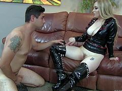 Long haired blonde milf Aiden Starr in black mistress outfit made of latex is a kinky domina with nice bare butt. She puts on a face sitting show with naked obedient guy in the middle of the room.