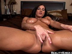 Delightful brunette with juicy tits lies down on the bed and fingers herself. After that she gives a blowjob & titjob combo and gets fucked doggystyle.
