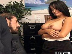 Brunette bombshell Sophia Lomeli is getting naughty with some stud in an office. She lets the dude eat her vag and then they fuck in missionary position on the desk.